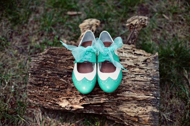 Brides turquoise color shoes on a log