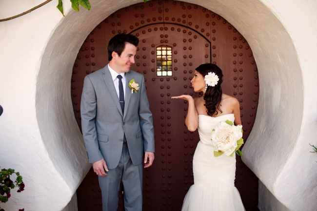 Bride blowing a kiss to her groom