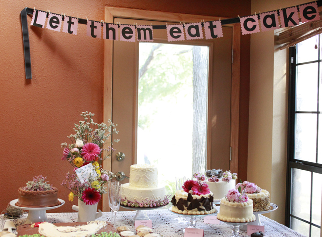 "dessert table with banner above that reads ""Let them eat cake"""