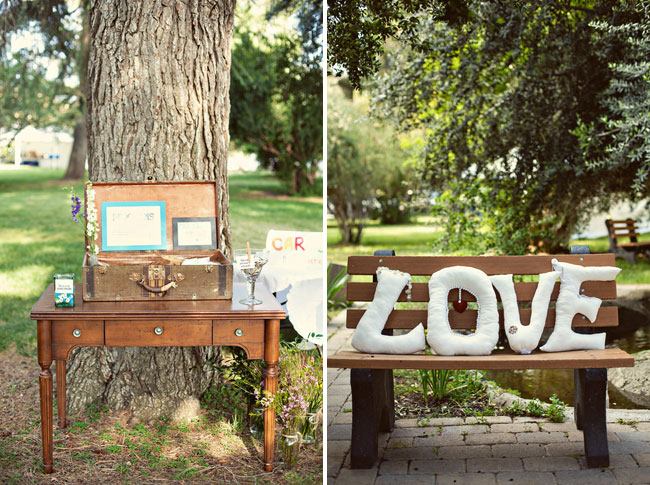 Vintage wood desk in front of tree with open suitcase on top at Highland Springs Resort. Giant pillows in the shape of the word LOVE
