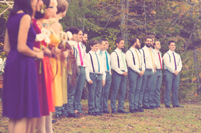 rainbow colored bridal party attire during wedding ceremony
