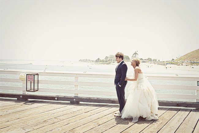 Bride and groom on pier at Surfrider beach for First Look