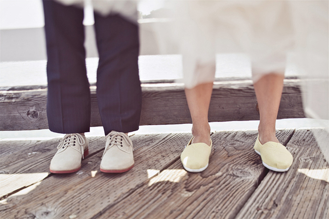 groom in white sneakers and bride in yellow flats