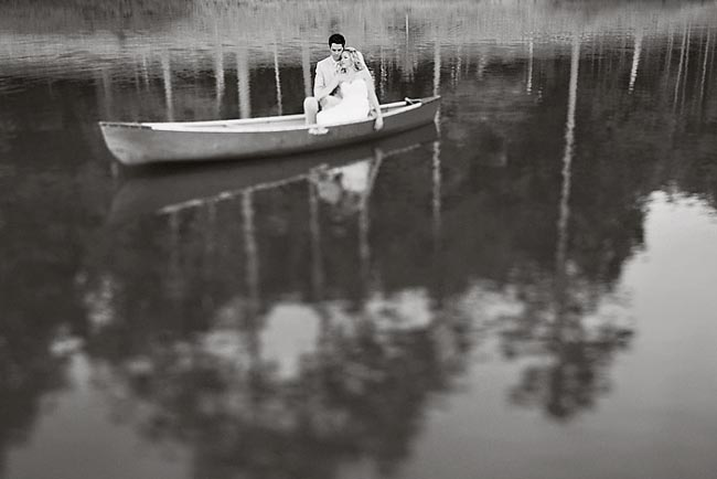 black and white photo of bride and groom in canoe on a Georgia lake