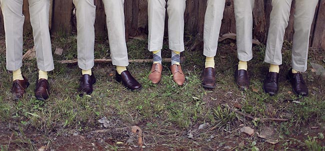 Groomsmen show off their yellow and gray argyle socks