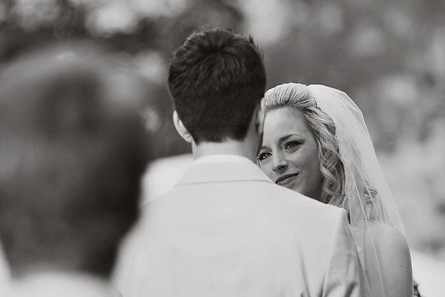 black and white photo of bride looking into groom's eyes