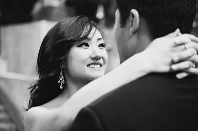 B/W photo of bride looking into groom's eyes