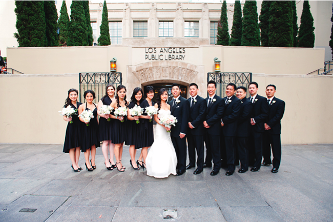 Bridal party standing outside Los Angeles public library building