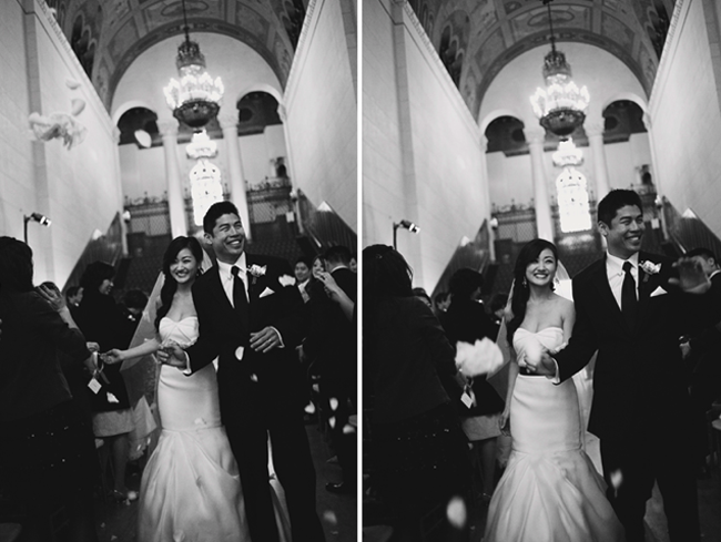 B/W photo of bride and groom walking down aisle at Los Angeles library wedding ceremony