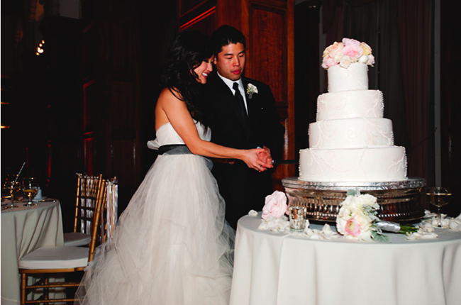 Bride and groom cut their 4-tier wedding cake at The Legendary Park Plaza Hotel reception