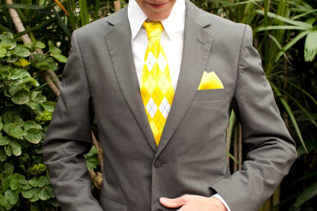 Groom in gray suit, bright yellow necktie and matching pocket square