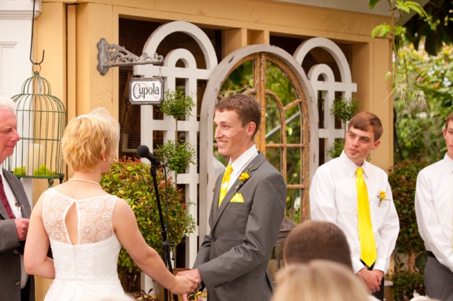 Bride and groom standing at wedding ceremony at Cactus & Tropicals