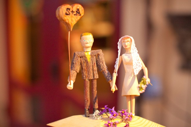 Hand carved bride and groom figure cake topper