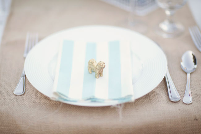 striped blue and white napkin with figurine dog