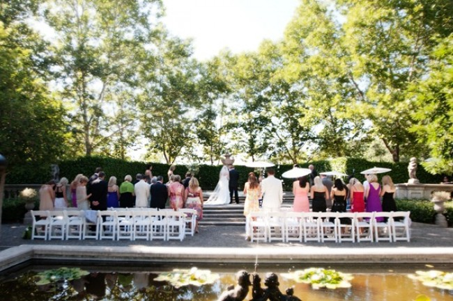 Sunny outdoor Beaulieu Garden wedding ceremony in front of pond