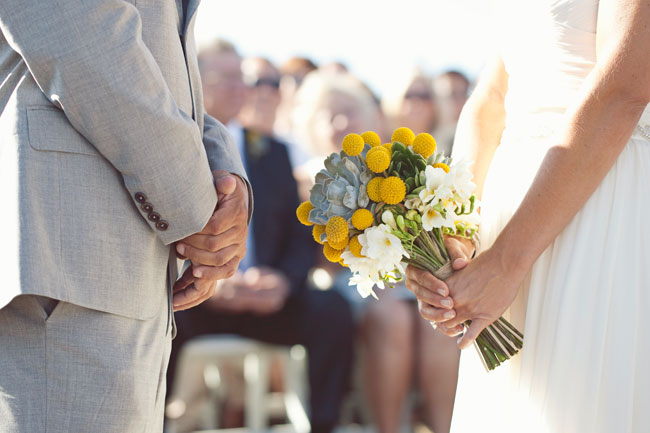 bride holding billy ball bouquet