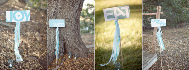 handmade signs with baby blue streamers