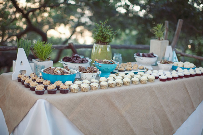 dessert table with cupcakes, squares, and chocolate treats!