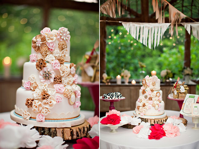 3-tier cake sitting on wood slice with pink and beige rose designs