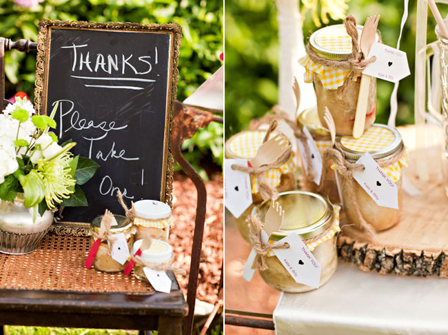 "DIY mason jars with yellow checkered tops and twine, chalkboard sign that says, ""Thanks please take one!"""