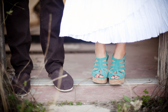 Groom wearing sneakers, bride wearing turquoise peep toe heels