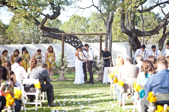 outdoor yellow wedding ceremony at The Gardens at West Green