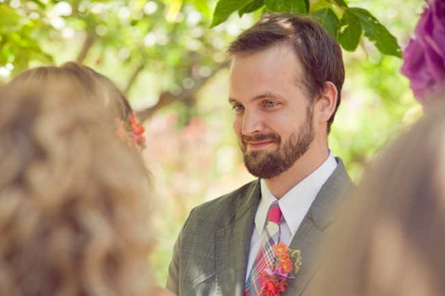 groom in striped tie and gray suit