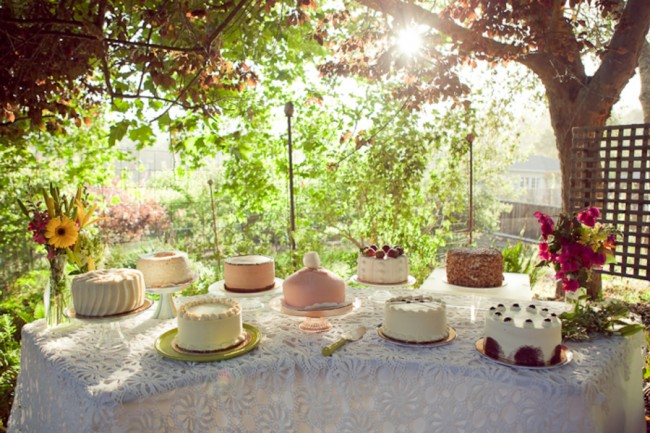 dessert table with nine different cakes