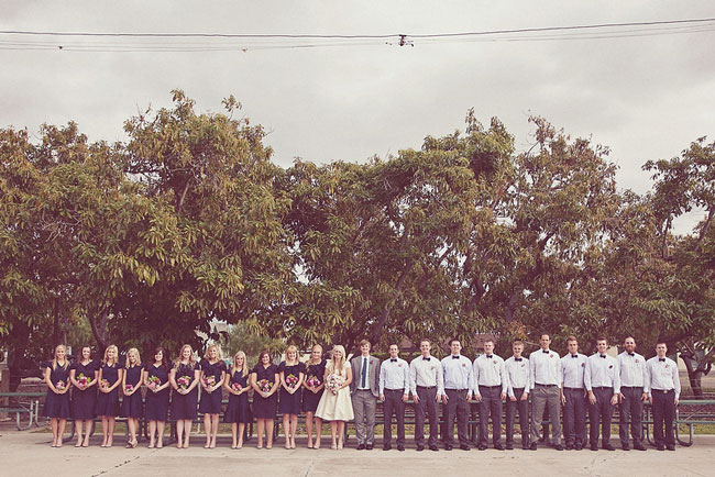 11 bridesmaids and 10 groomsmen all in a row