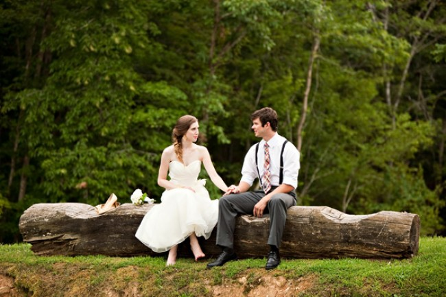 couple sitting on log at Moonshine Hill