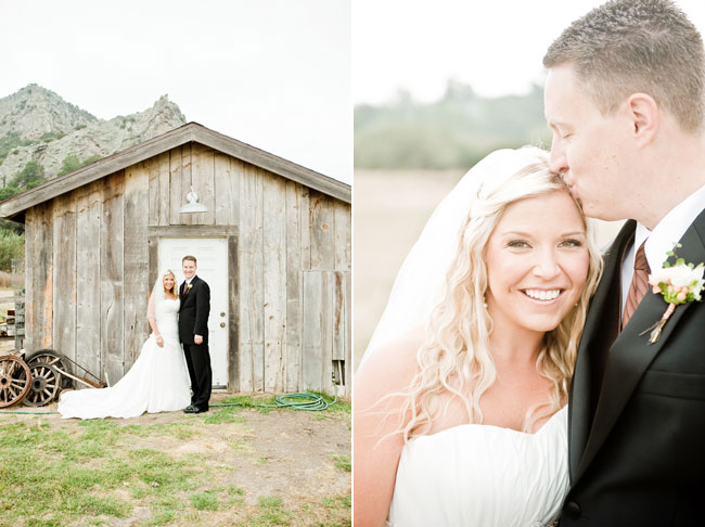 bride and groom stand in front of rustic barn at Holland Ranch