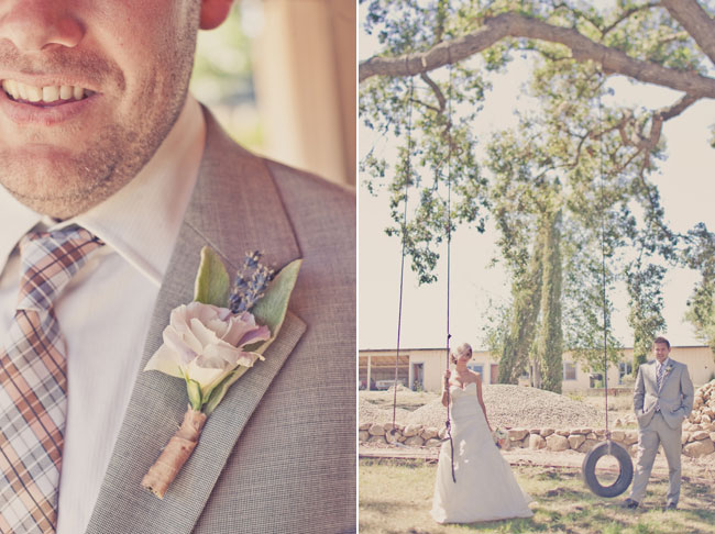 Groom with soft pink flower boutonniere and checkered tie. Bride and groom stand next to tire swing hanging from tree