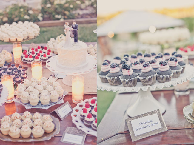 Chocolate and vanilla cupcakes with fresh blackberries and rasperries on top sit at wedding dessert table, Sogno Del Fiore