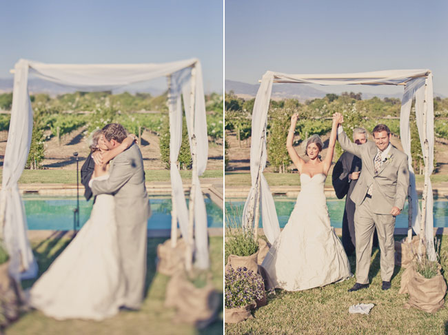 Bride and groom kiss at wedding ceremony at Sogno Del Fiore winery