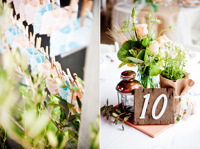 wood table number, peach roses, and mini candle lantern in centerpiece