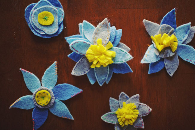 DIY felt boutonnieres in blue and yellow flower shapes