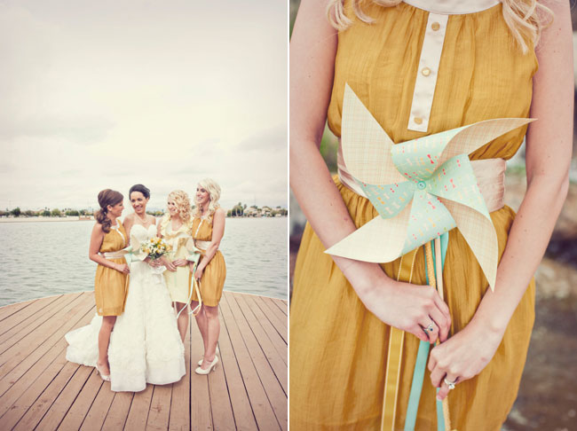 bridesmaid in mustard yellow dress holding pinwheel