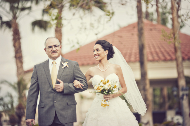 bride and her father walk down aisle at Val Vista Lakes wedding ceremony
