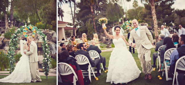 Recessional with bride holding up bouquet