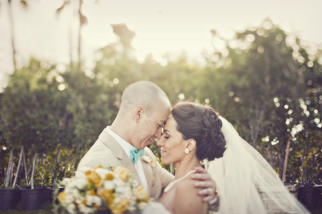 bride and groom together with eyes closed