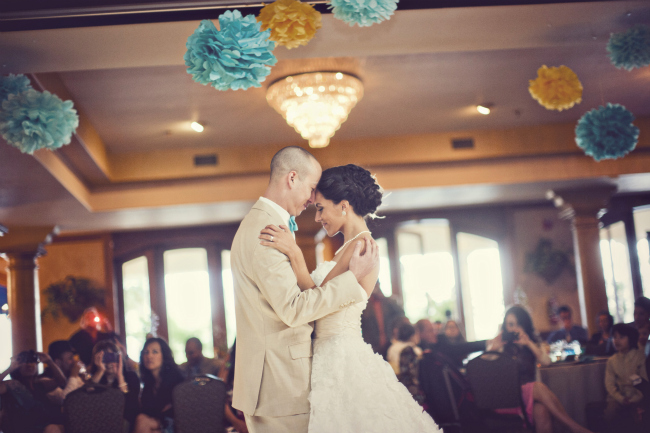 first dance with turquoise and yellow pom poms above