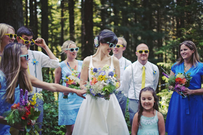 bridal party wearing colorful sunglasses for Hoyt Arboretum wedding ceremony