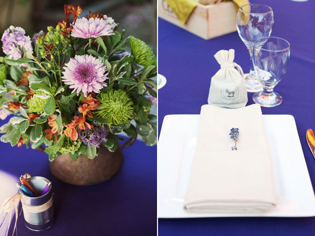 wedding table centerpiece on purple tablecloth
