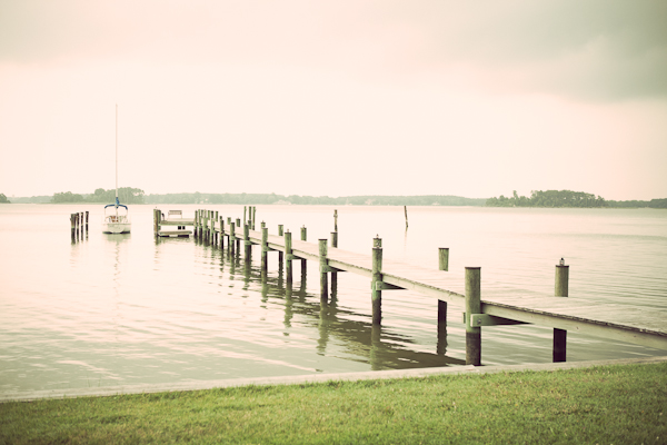 Lake front with long dock and sail boat in Maryland