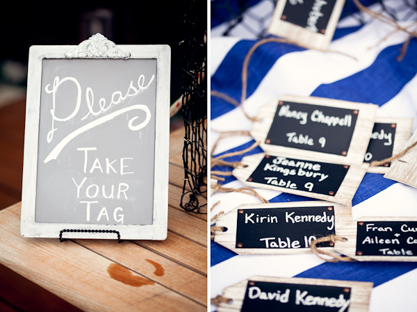 "Chalkboard sign with ""please take your tag"" for wedding reception guests (left photo); Wedding reception guest place card tags on blue and white striped table cloth (right photo)"