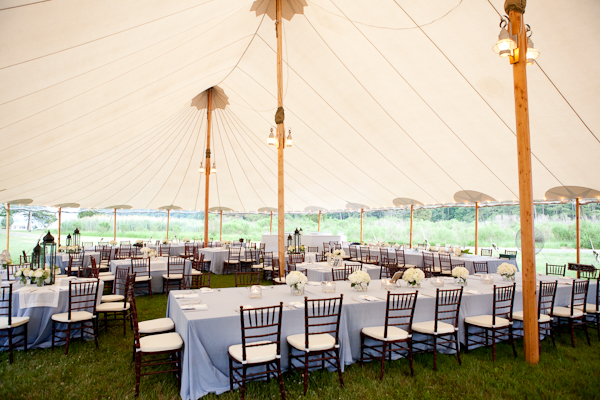 Elegant blue and white striped tent wedding reception with chevalier chairs