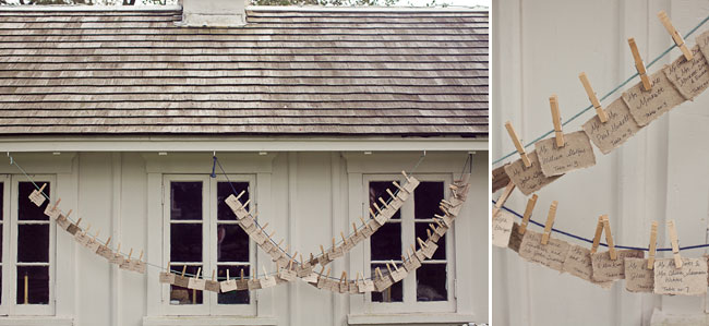 table cards hang with clothespins are strung from house at Mount Hope Farm
