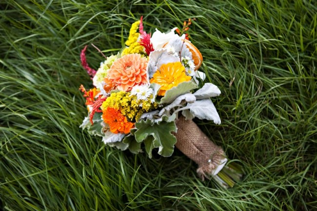 Colorful wedding bouquet laying in grass