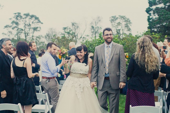 Couple walk down outdoor aisle after wedding ceremony at Mount Hope Farm in Rhode Island
