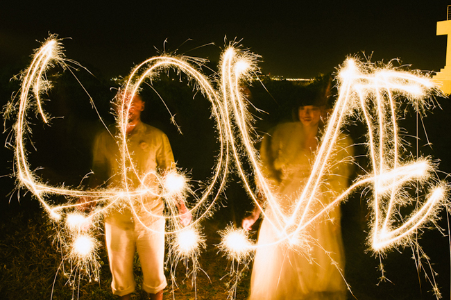 Beach Wedding sparklers spelling word LOVE
